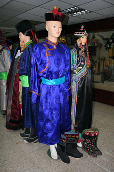 Manaquines wearing Mongolian clothes with different variety of boots