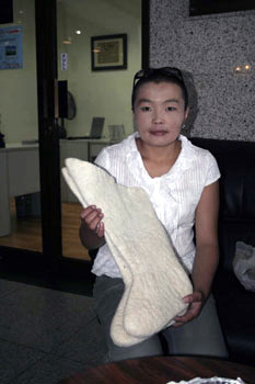 Lady showing thick Mongolian boot linings