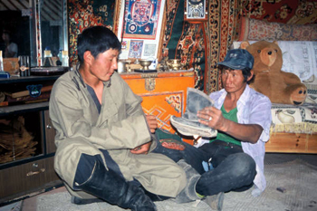 Photo of men holding picture of child's Mongolian Boots